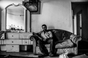 Abdelkafy takes a break inside a simple flat dedicated for the shop's workers .