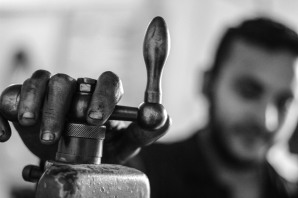 Abd Elmoaen, 18 years old, Syrian young man works in a workshop for the lathe owned by Syrian men in Burj Al Arab industrial zone in Alexandria. Abd Elmoaen lives with his family at the same area, and he said that he was working to support his family.