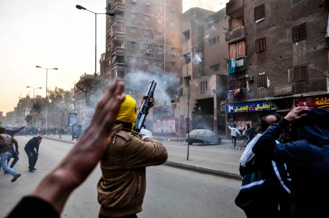 Supporters of Egypt's ousted President Mohammed Morsi damage a police building in Cairo's Ain Shams district, Egypt, Friday, Feb. 7, 2014. Clashes between Egyptian security forces and Islamist protesters left one person dead in a province southwest of Cairo on Friday while two home-made bombs targeting policemen wounded six people in a bridge in the capital